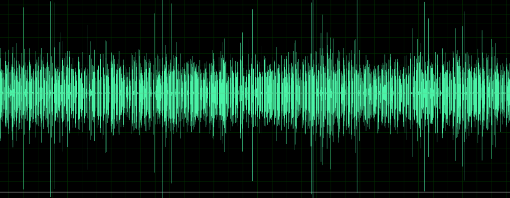 A full screen of unedited audio shows in green waves on a black screen. Most of it is generally the same size except for the occasional vertical line from top to bottom.