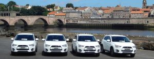 Cars on the quayside: the fleet used in Berwick to ferry cancer patients on the hundred-mile round trip for hospital visits. Below, some of the Berwick volunteers who help their neighbours with a lonely, frightening illness.