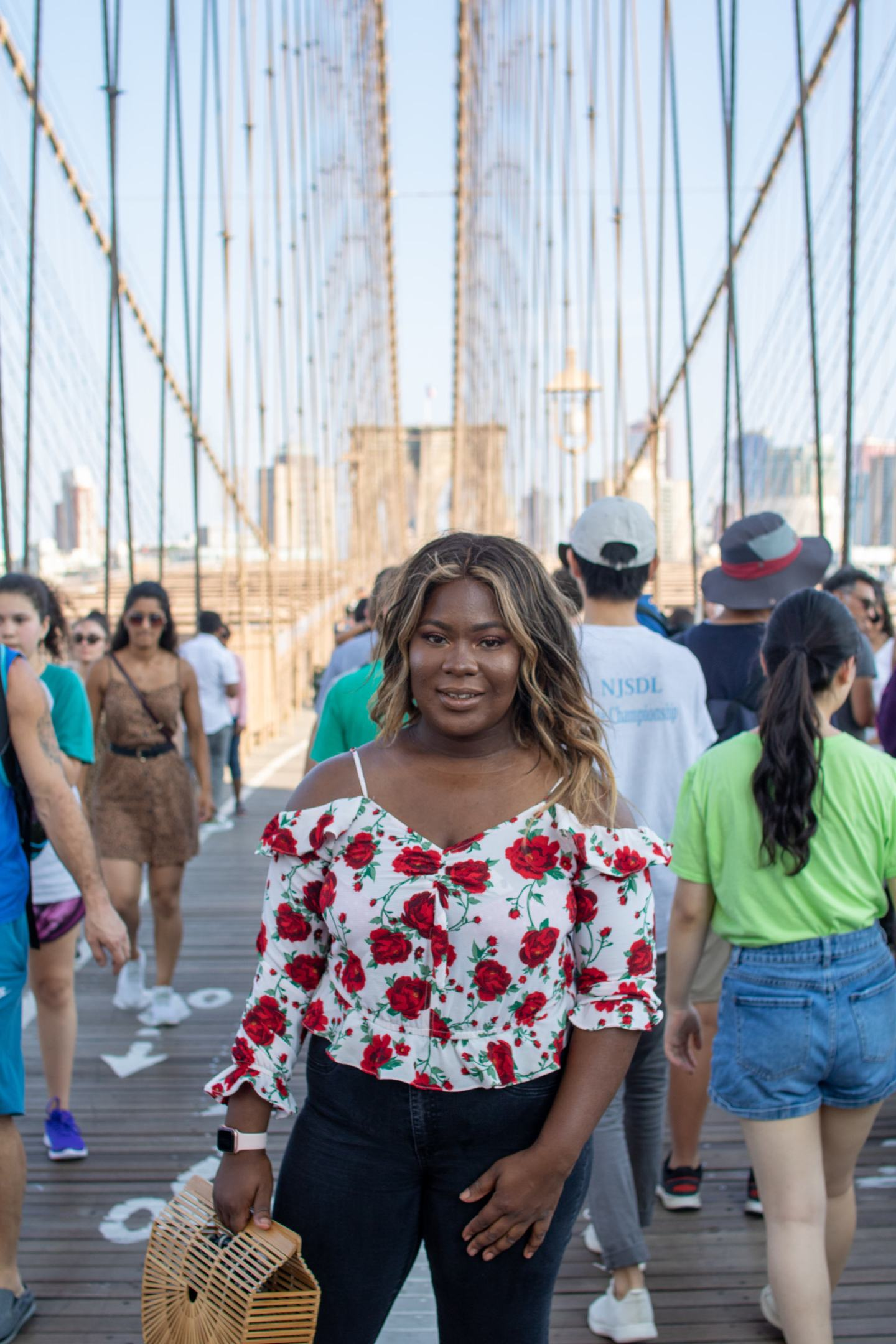 Vera standing on Brooklyn Bridge in nyc