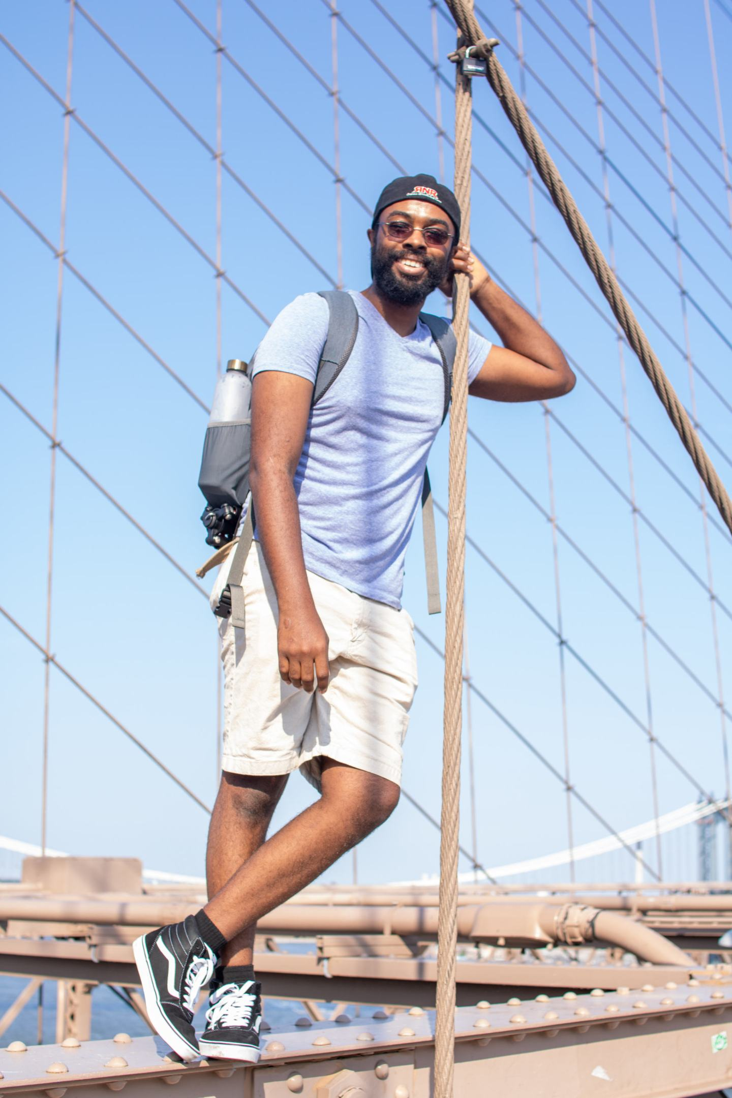 chris standing on Brooklyn bridge in nyc