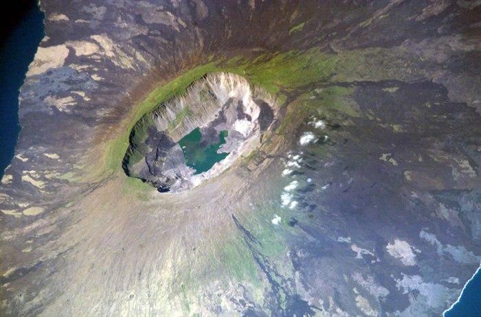 The approximately 4 by 6½-km wide Summit Caldera of the 1,476 m high La Cumbre shield volcano on Fernandina Island, Galapagos (WikiMedia)