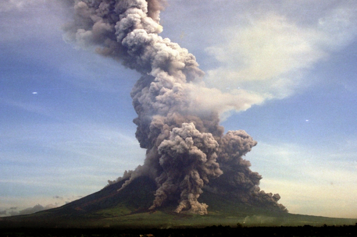 Pyroclastic flows travelling down the flanks of Bulkang Mayon during its 2001 eruption (VEI 3, Strombolian-Vulcanian). Even if the small summit crater is breached to the southeast, this image clearly demonstrates one of the difficulties PHIVOLCS faces when assessing which areas are to be included in the danger zone as the almost perfect symmetry of the mountain makes it virtually certain that pyroclastic flows will travel down most if not all of its flanks. (Maslog City Photos, R. Madronero)