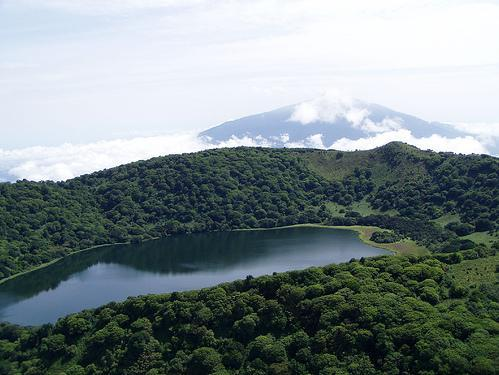 Beutifal shield crater lake with a shield in the background. Pico Basile volcano on Bioko Island.