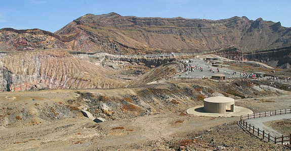 """Tourist facilities inside the spectacular crater of Mt Nakadake. A notice on the website informs the visitor that """"Due to increased volcanic activity, a no-entry zone is currently maintained that stretches one kilometers from the crater and results in the closure of the ropeway, road and hiking trails to the crater. It is currently not possible to see the crater."""" (japan_guide.com)"""