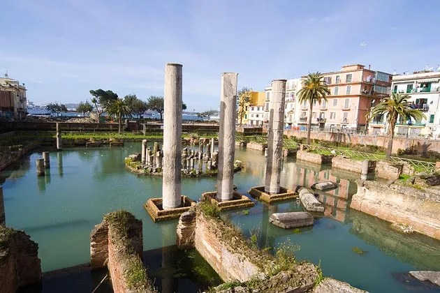 The formerly submerged Macellum (market building) of the Roman colony of Puteoli, now known as Pozzuoli. The discolorations visible on the columns indicate the former sea level. (Photograph by Angela Sorrentino)