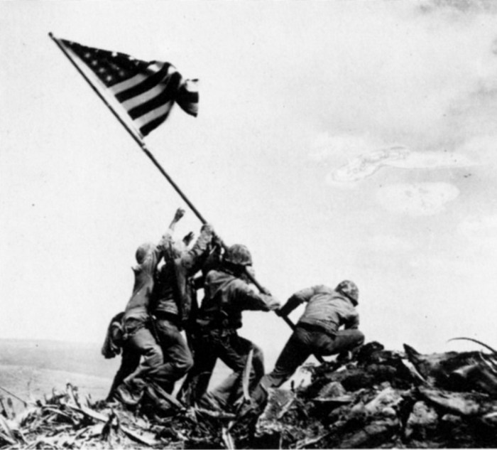 """As we raise the flag for Ioto, formerly known as Iwo Jima, we cannot fail to mention """"Raising the Flag on Iwo Jima"""", the historic photograph taken on February 23, 1945, by Joe Rosenthal. It was a re-enactment, it does not represent the actual moment the island was captured earlier the same day and wasn't even the first """"Star Spangled Banner"""" to be flown at the mountain summit."""