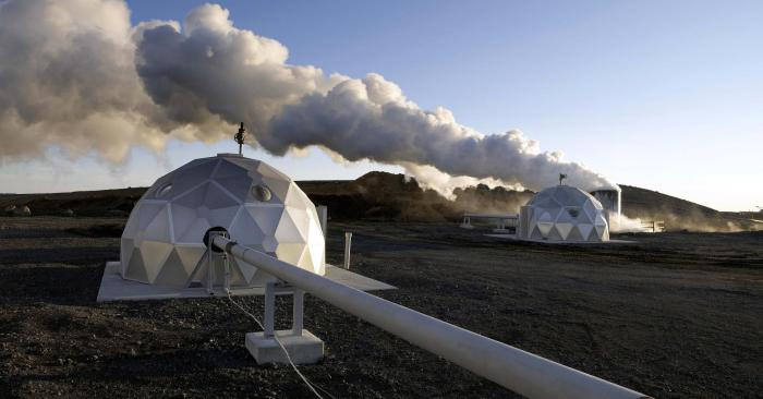 Geothermal plant boreholes with muffler and distribution domes.