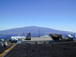 >The Mauna Loa Observatory. In the background is Mauna Kea - Mauna Loa is behind you.