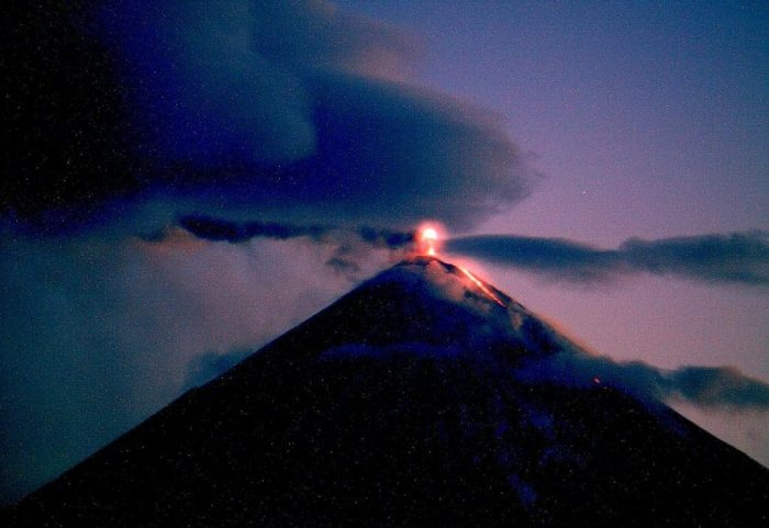 Kluychevskaya Sopka at 07:30 UT on October 6th 2013, after local sunset. It is one of the most photogenic of volcanoes in the world and eruptions are frequent, almost always minor Strombolian accompanied by lava flows. (Kvert Webcam)