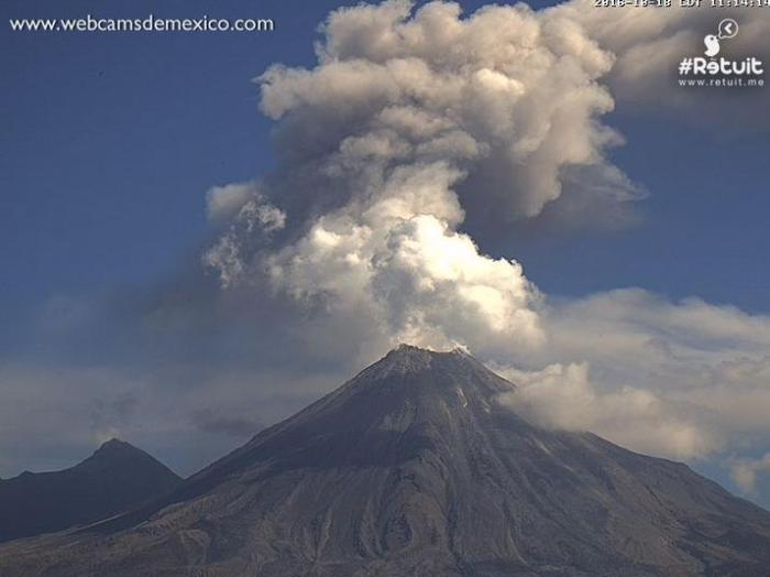 Volcán de Colima or Colima de Fuego in the foreground with the older Colima de Nevado in the background to the left. In this screengrab, it appears as if there is simultaneous activity at Nevado but this is unconfirmed. (Webcams de Mexico)