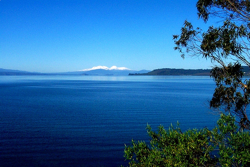 eautiful Lake Taupo, New Zealand. The only hint of its volcanic origin are the distant volcanoes on the horizon, built at the edges of the ring fault system. (Provenance unknown)
