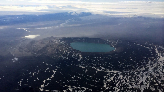 erial photograph of the sub-glacially formed Askja volcano with its large caldera containing the nested caldera of Lake Öskjuvötn, which resulted from post-eruption collapse following the volcano's 1875 VEI 5 eruption (RUV)