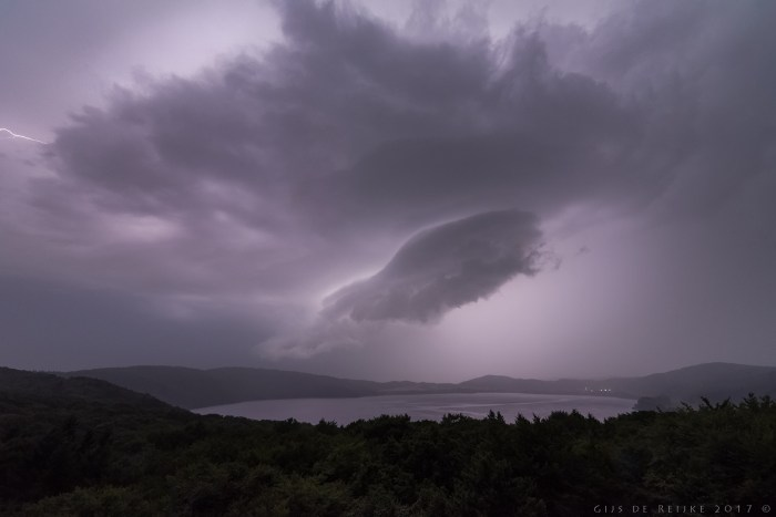 wide-angle shot of the Laacher See caldera during a thunderstorm. © Gijs de Reijke