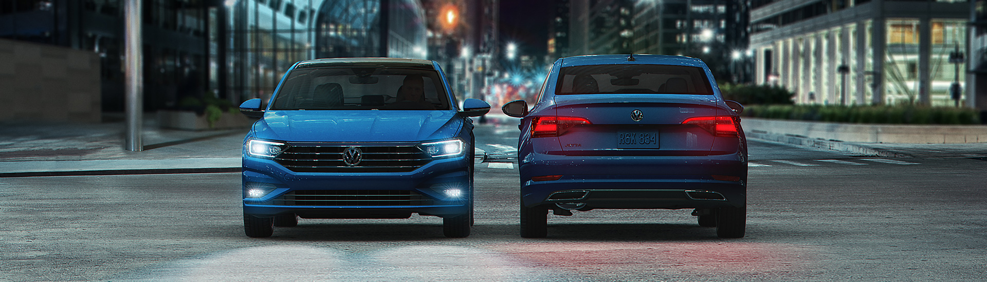 Two 2019 Jetta sedans front grill and rear view