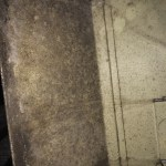 Interior photo of a furnace plenum is covered with mold growth in this Lake City, TN home.