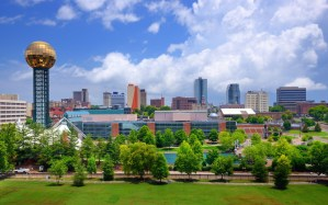 View of Knoxville TN Skyline with Sun Sphere on left side and Convention Center
