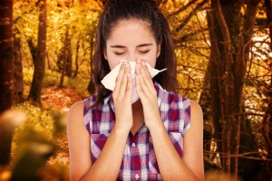 Woman sneezing from Allergic reaction to contaminates
