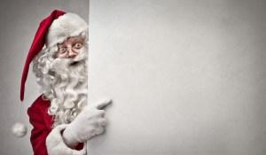 Santa peeking out from behind the wall.