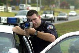 Police officer shooting a Kustom ProLaser II lidar gun
