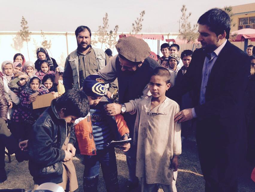 Vox Infantis Kunduz school -  distribution of warm clothes  10 January 2015 by the guests attenting the opening ceremony