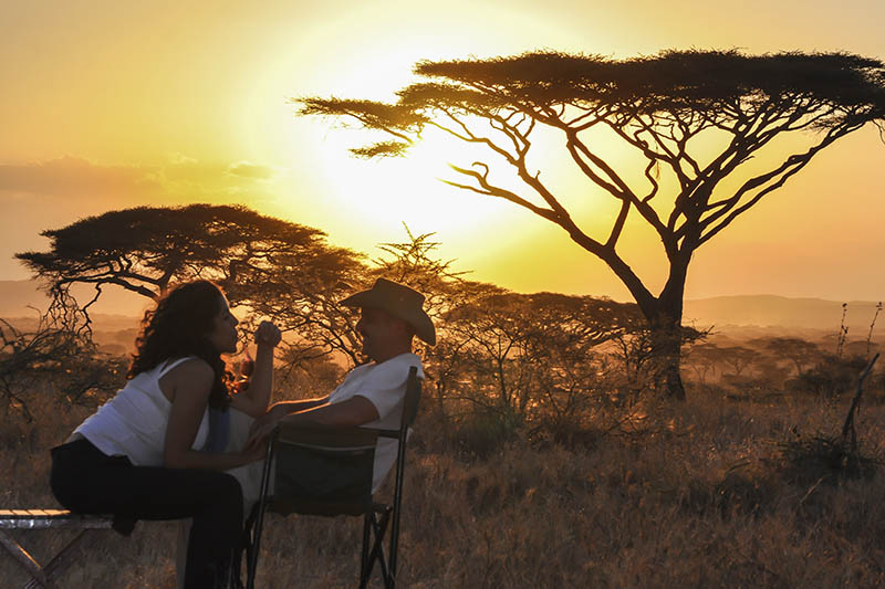 zimbabwean enchantment - hwange-national-park-packages-zimbabwe-destinations-journey-in-style-southern-africa-couple-sunset