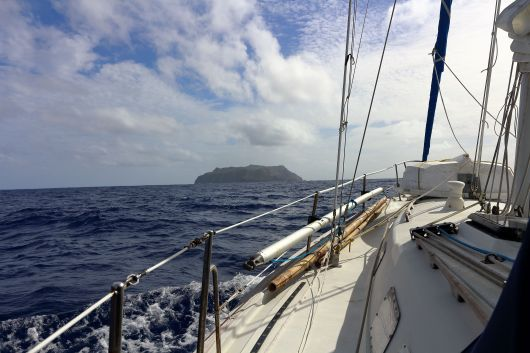Our first view of Pitcairn - the first land we'd seen after our 23 day passage from Galapagos