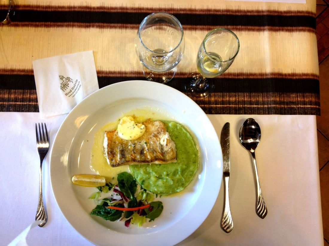 Grilled pike perch with lemon butter, mashed potatoes and arugula at the Hnevin restaurant - Northwest Bohemia, Czech Republic