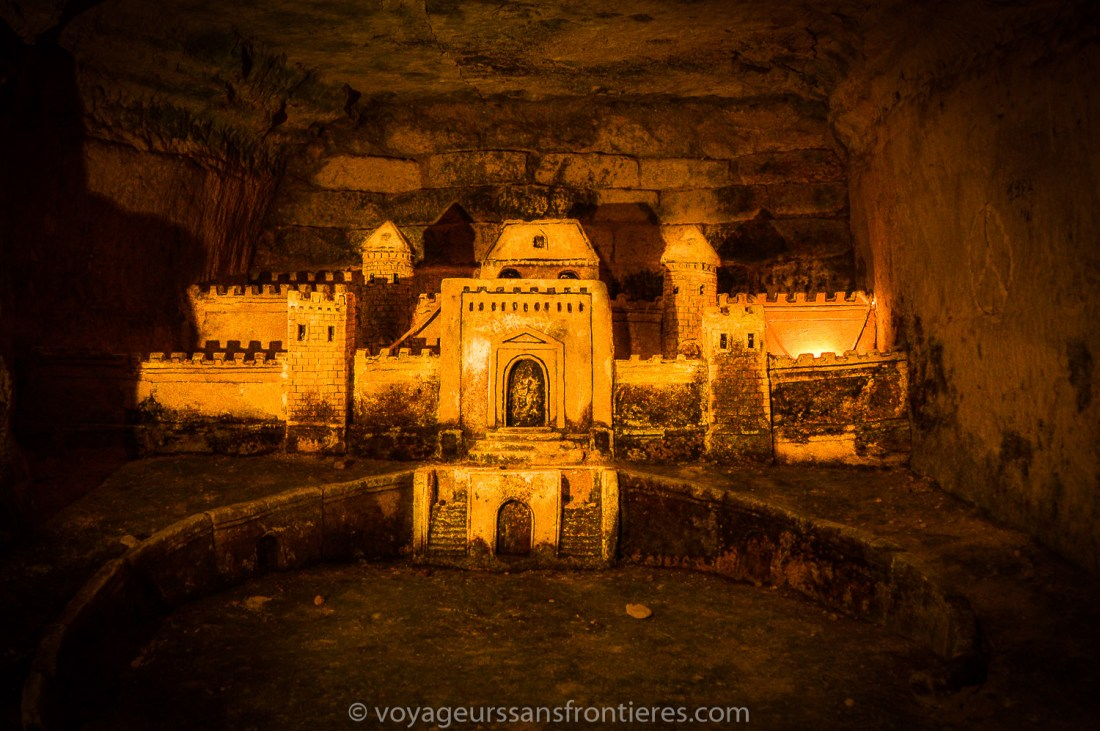 A carving of a castle - Paris catacombs, France