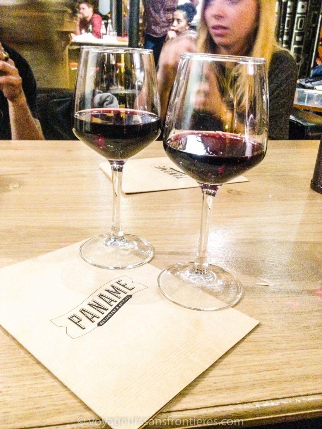 Two wine glasses at the Paname Art Café - Paris, France