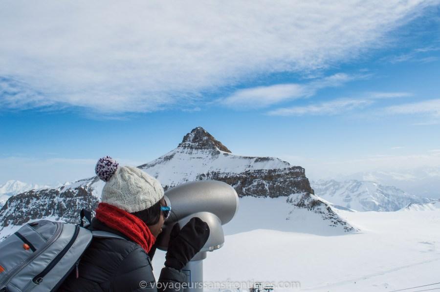Nath looking at the peaks through binoculars - Glacier 3000, Switzerland