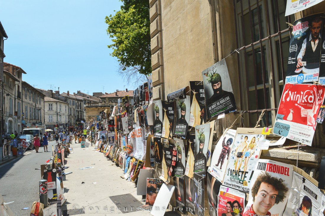Colorful posters in the streets during the Avignon Festival - Avignon, France