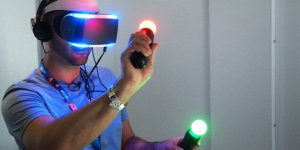 Man using Playstation VR headset and move controllers
