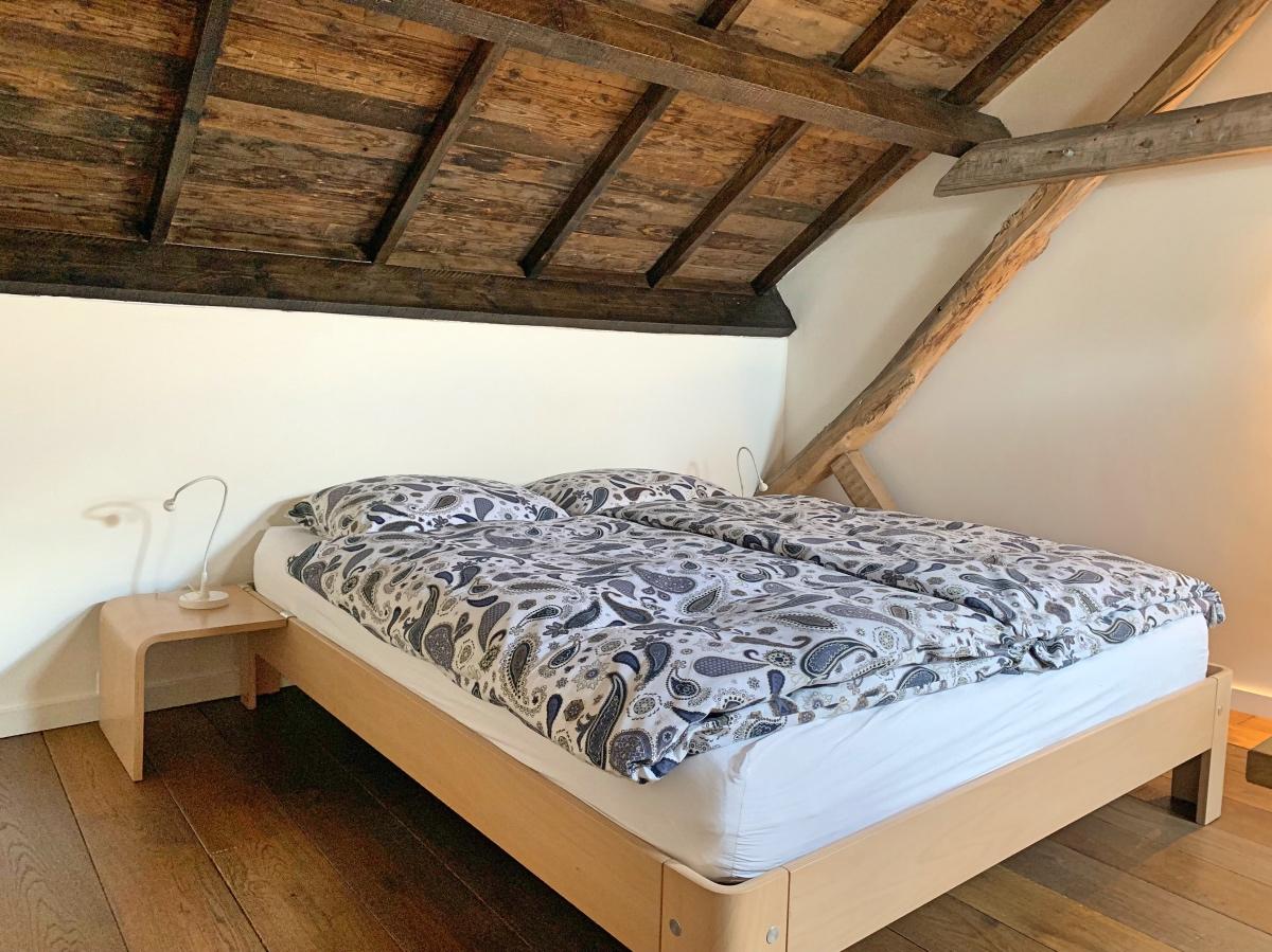 Slaapkamer van appartement 'koeienstal' B&B In Bemelen