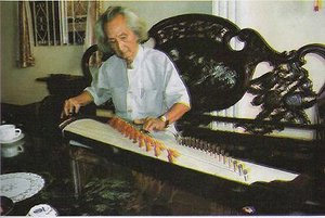 Music Professor Nguyen Vinh Bao in the south playing the zither