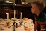Даня задувает свечи после завтрака на ферме Берлуда