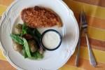 Куриное филе в ореховой панировке с салатом из молодого картофеля и зеленого горошка