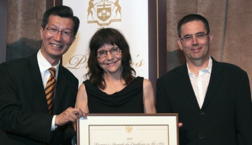 Ontario Minister of Tourism and Culture Michael Chan (left) presents the Premier's Award for Excellence in the Arts to Vtape co-founders Lisa Steele and Kim Tomczak