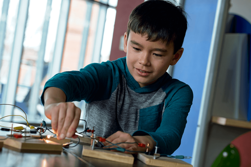 Image of young boy playing with electricity experiments
