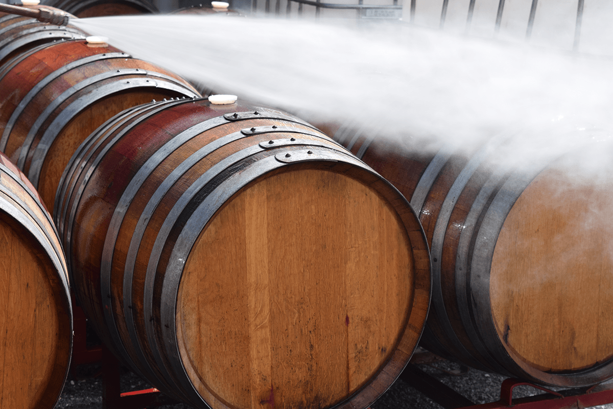 Image of barrels being washed down