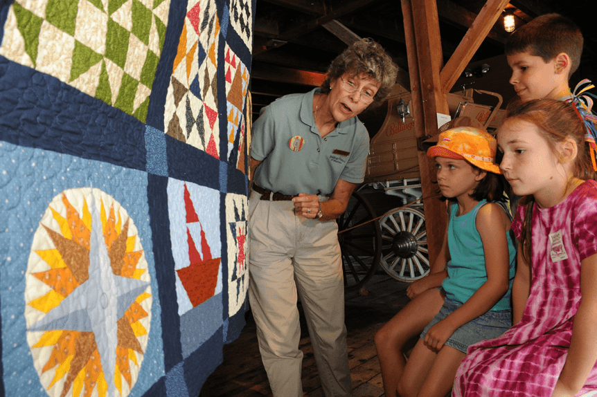 Image of people looking at the Billings Farm underground quilt