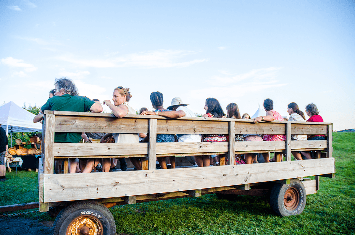 Image of people taking a wagon ride