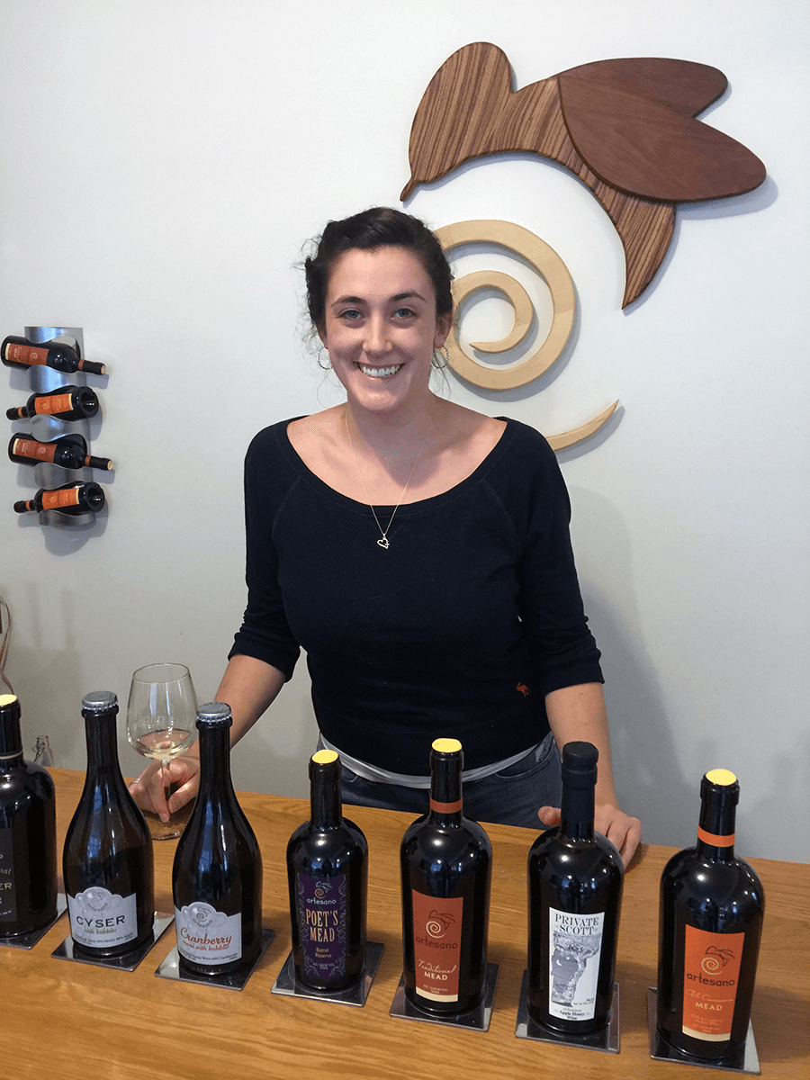Image of woman behind the bar at Artesano Meadery