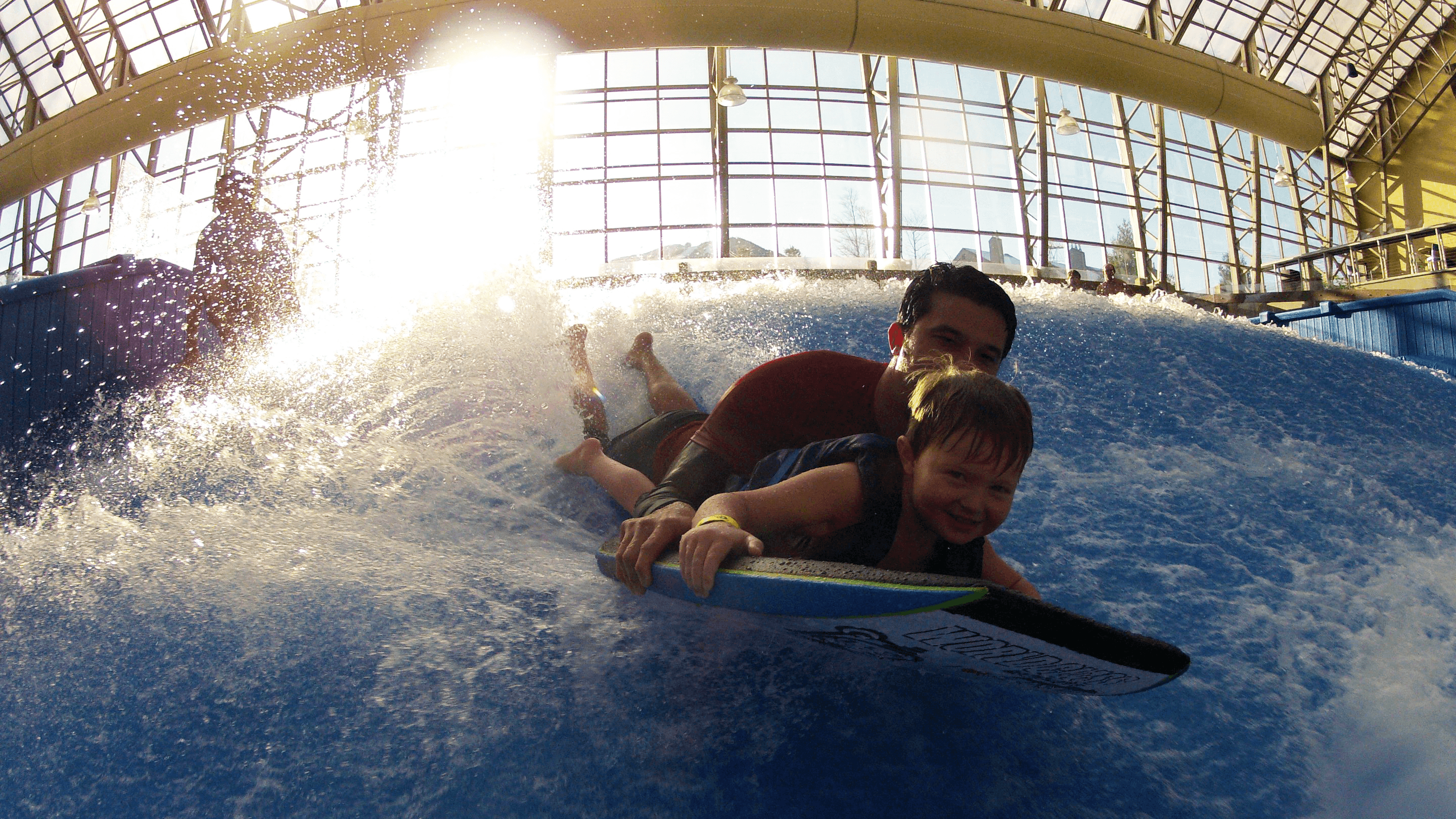 Image of father and son on the Jay Peak Resort Flowrider