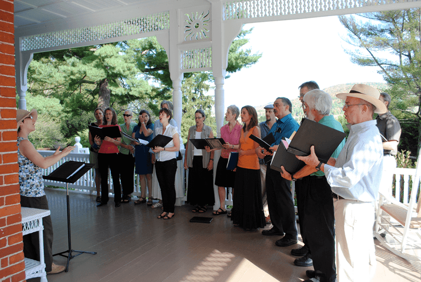 Image of choir singing on the porch