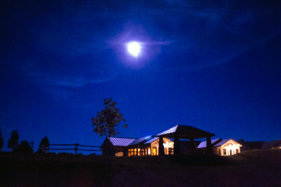 Image of moonlight over the cabins at Saint Anne's Shrine