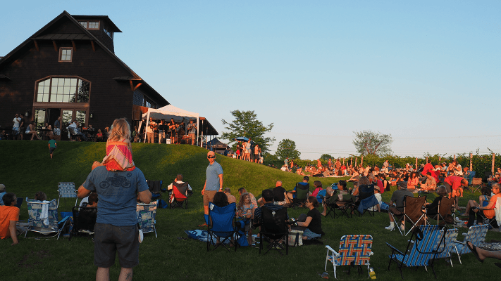 Image of people on the lawn behind the tasting room