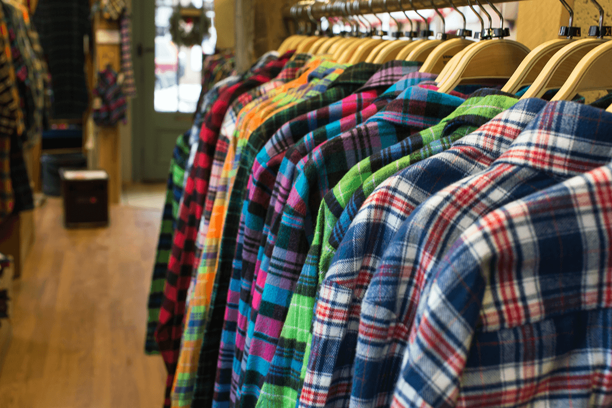Image of flannel shirts on hangers in store