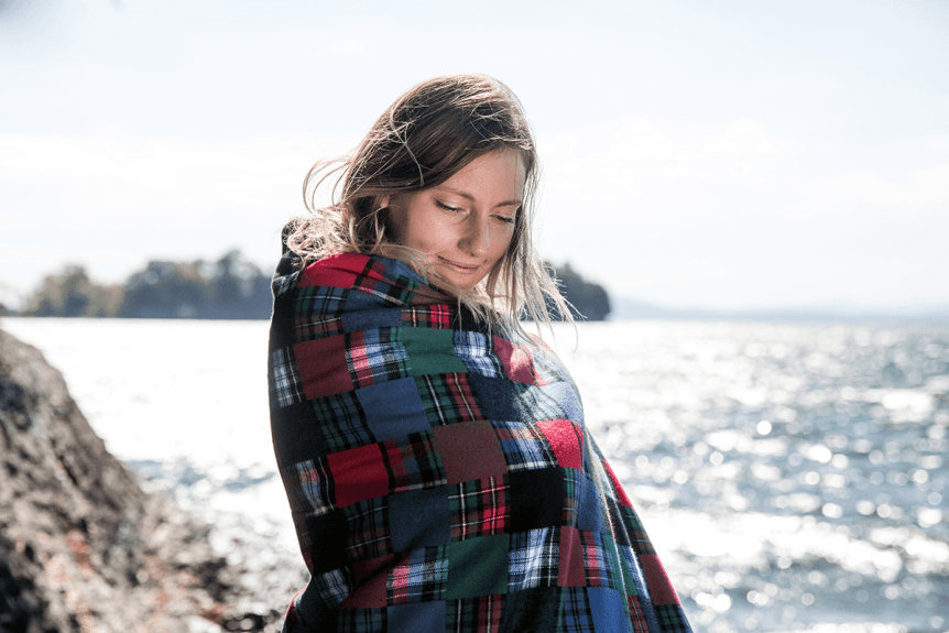 Image of woman wrapped in flannel blanket