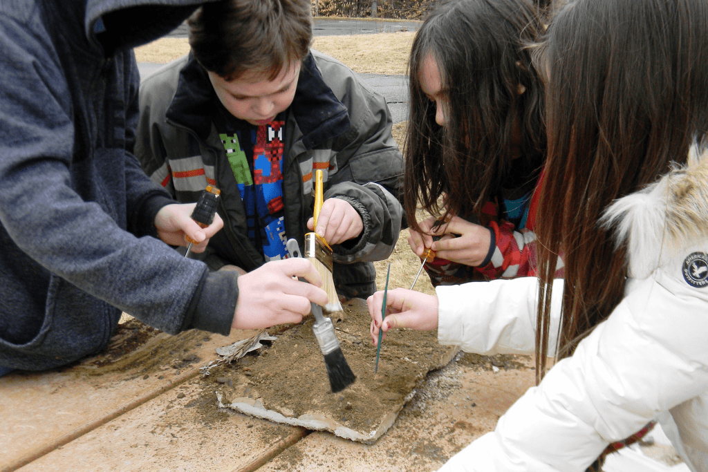 Image of children excavating a fossil