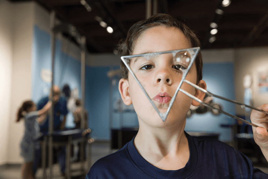 Image of boy blowing bubbles at Montshire Museum of Science